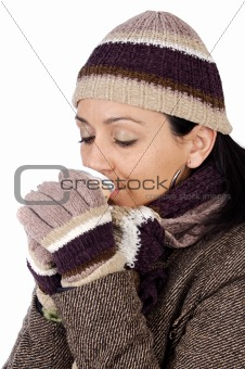 attractive lady sheltered for the winter drinking a tea cup