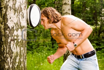 Caucasian strong man playing rugby ball outdoors