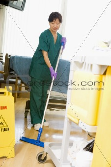 An Orderly Mopping The Floor In A Hospital Ward