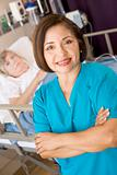 Doctor Standing With Arms Crossed In Her Patients Room