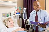 Doctor Making Notes About Patient,Looking Serious