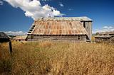 Rustic Barn Scene with Deep Blue Sky and Clouds
