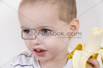 little boy with peeled banana