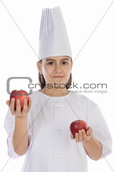 Adorable cook girl with apples