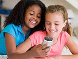Young Girls Playing With A Cellphone