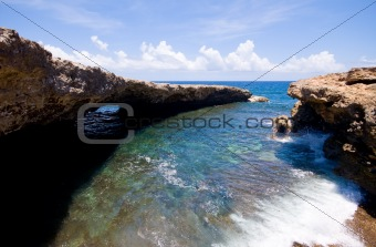 rocky shore with natural bridge, rocky shore inlet with natural bridge