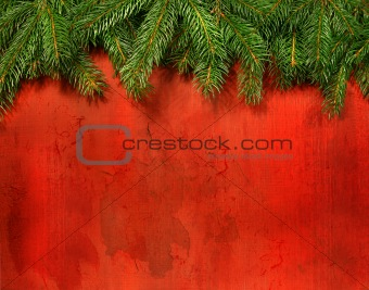 Branches of pine against rustic red wood