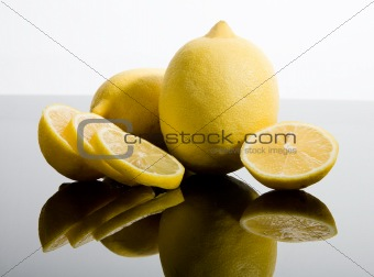 Sliced and whole lemons