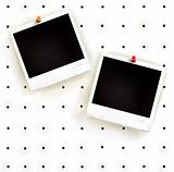 White peg board with photo frames