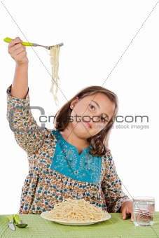 Precious girl eating spaghetti