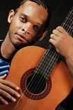 African man with acoustic guitar