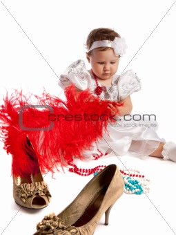 Little girl holding big red feather, isolated