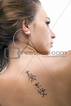 Tattoo on a back of the young woman. Isolated 3