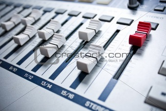 white mixer with red master in studio