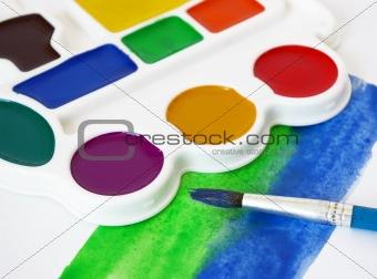 Box of watercolors and brush