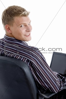 smart guy with laptop looking at camera