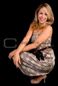 Beautiful Smiling Blonde Lady in a Beige Dress