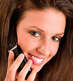 Beautiful Smiling Woman Talking to a Cell Phone
