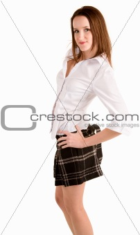 Beautiful Brunette in a Plaid Skirt and Blouse