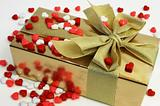 Wrapped Gift Surrounded by Heart Shaped Candies