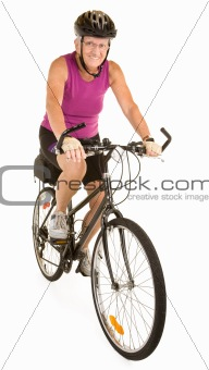 Fit Senior Woman Riding a Bicycle