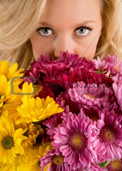 Beautiful Woman's Eyes Looking Over Flowers