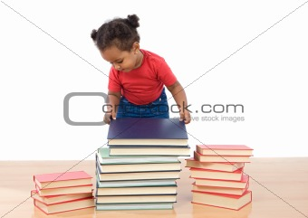 Adorable african baby ordering many books