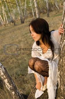 beauty girl sit on the birch tree 3