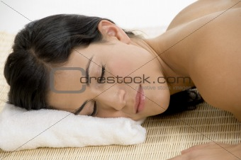 young woman sleeping on mat