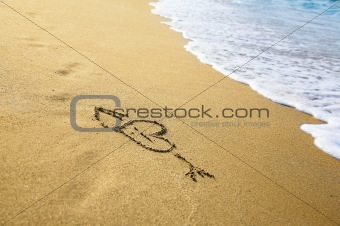 """Heart"" drawing at sand, with sea wave"