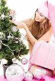santa helper girl decorating christmas tree