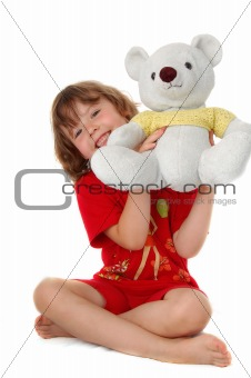 Young girl sitting on the floor with two teddy bears