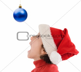 Boy looking at ball of Christmas
