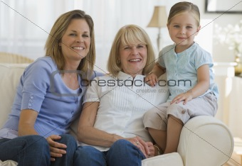 Three generations sitting on couch