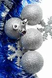 Silver bulbs with snowflakes and blue tinsel