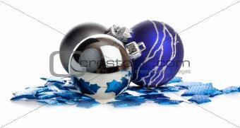 Christmas balls lying on blue stars