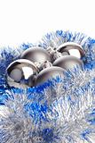 Christmas balls with silver and blue tinsel
