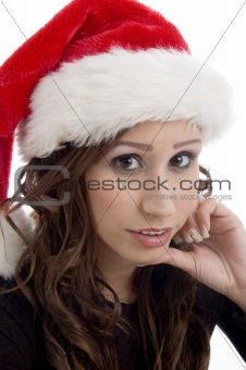 close up of woman wearing christmas hat