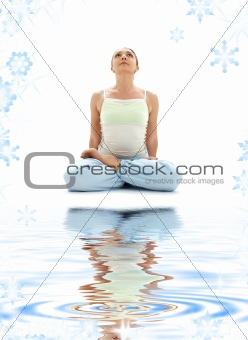 padmasana lotus pose on white sand