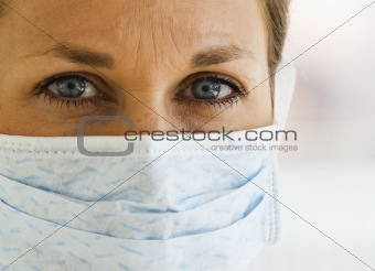 Close up of Female Doctoris eyes with Mask on