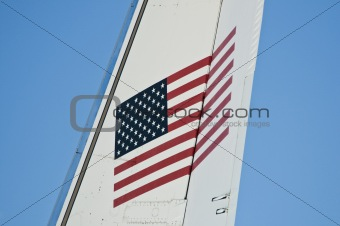 american flag on tail of airplane
