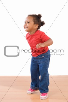 African baby girl on tiptoe