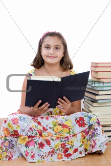 Adorable girl reading