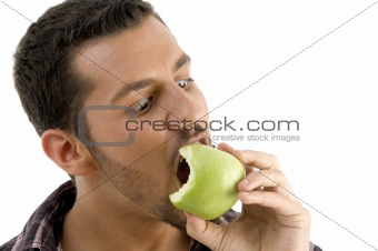 man eating green apple