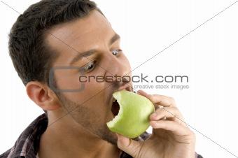 man eating green apple