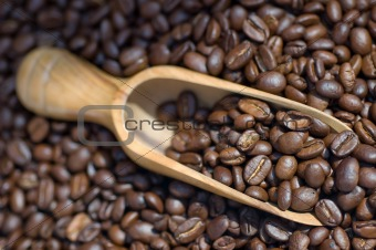 Close-up macro coffee beans wooden scoope