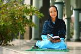 Muslim Girl Reading Qur'an