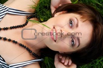 beautiful woman lies on a grass