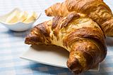 Fresh croissant with butter