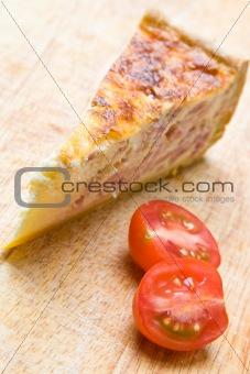 Bacon quiche with a tomato